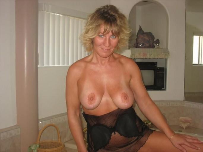 lady rubbing boobs